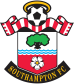 Formed in 1885 by members of St. Mary's Church Young Men's Association the club known still to this day as The Saints did not knowingly wear a crest on their shirts until 1974. Previous to that the club was represented by their town's coat of arms. In 1973 The Saints launched a competition to design a new crest for the club to launch in the 74/75 season. The winning design represented the local area and the clubs history including a Hampshire Rose, a tree to represent the nearby New Forest, a scarf to represent the fans complete with a halo for the founding saints. With small tweaks throughout the 1980s the club released its only major change to the design in the mid nineties with an adaption of the Football in the top centre of the crest. This change apparently came in so the club could fully copyright the crest as their own. For the clubs 125th anniversary The Saints adopted a commemorative crest for the 2010/11 season. Then in 2013 a one off kit special appeared in a simple gold and red colour scheme. Thankful the club reverted to the full colour classic the following season.