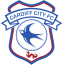 "From 1908 Cardiff played in unadorned shirts. This changed in 1959, when they played in shirts with a simple crest featuring an image of a bluebird. The following season their shirts were featureless, and remained so until 1965, when they played in shirts with the word ""Bluebirds"" embroidered. A new crest, similar to the one previously used and again featuring a bluebird, was introduced in 1969. Variations on this crest remained until the 1980s, when extra features including words and additional motifs were added. A major change was made in 2012, when owner Vincent Tan attempted to rebrand the club in order to expand the club's appeal outside Wales. This change gave large prominence to the Welsh Dragon, reducing the bluebird to a minor feature. In March 2015, Cardiff announced a new crest which would predominantly feature the Bluebird once again with an oriental dragon replacing the standard Welsh dragon."