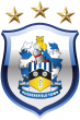 The current club crest uses one of the most popular badges, but adds the three stars for the three successive league titles won by Town in the 1920s. The badge is surrounded by a shield, with the stars floating above. This crest has been used by the club since 2002.