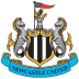 As iconic as our famous black and white stripes and as unique as the silhouette of St. James' Park, our club crest captures the identity of Newcastle United and the city of Newcastle upon Tyne. The club's current and perhaps most famous crest – synonymous with the Entertainers Era of the mid-nineties – was created in 1988. It heralded the return of the overall shape and several elements from the city's Coat of Arms, namely the supporting seahorses, castle, demi lion and an amended pennon. Inside an inner shield, gilded in gold, the club's black and white stripes were added while the club's name was added in a grand, scrolling blue banderole.